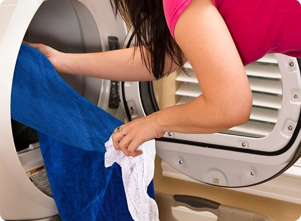 Make ironing easier by throwing wrinkled clothes in the dryer with a damp cloth set to the lowest heat setting before you start.